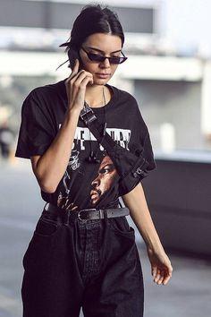 Kendall Jenner wearing  Vintage 1990s Ice Cube T-Shirt, Balenciaga FW 17 Sunglasses, Beats by Dre BeatsX Headphones