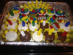 Lego birthday cupcakes professional look without the cost or time ... I bought the minifig cups off eBay for a couple bucks along with the foundant (12) already made delivered 2 days before party lego thes cupcake toppers for less than 20 dollars off eBay bake your own cupcakes an attach :)