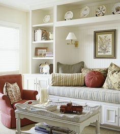 """built ins around window seat? use standard cabinets for the base of the bookcase, build shelves from 5/8"""" plywood.  The long shelf about seating should be anchored to wall and ceiling as well as the side bookcases."""