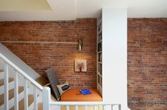 Utilize the dead space in a stair landing. | 21 Cozy Makeshift Reading Nooks