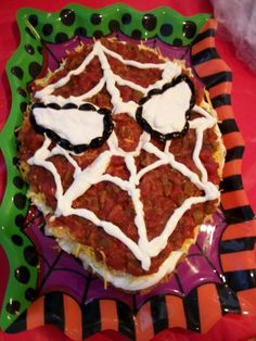Spiderman 7 layer dip! Also many Spiderman food, drink, and snack ideas on this page!!