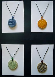 Cool clay pendants made from the imprint of students' shoes.  Texture!