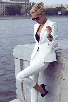 White on white with black accents, sunglasses and heels.