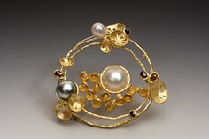 "Liaung-Chung Yen ""The Garden"" Brooch/Pendant. Comprising 18k gold, brown and white diamonds, pearls, and steel, brooch/pendant"