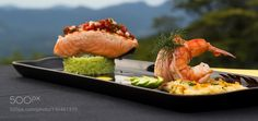 http://500px.com/photo/190461379 Salmon and Prawn Seafood Entree by sanda3cs -Salmon and Prawn Seafood Entree on a black platter. Laid on a table in an outdoor setting.. Tags: freshcloseuphealthyfishfoodplatemealprawnlunchdinnerricesalmondeliciouscuisinegourmetshrimpseafoodgarnish