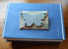 Use old cereal boxes to make gift card holders. I don't like the embellishment - what else could one use?