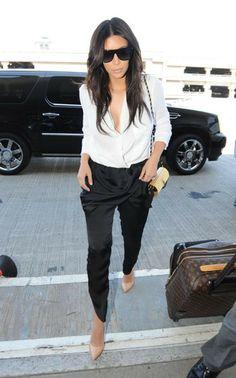 Au Revoir LA! Kim K Jets To Paris In A Revealing White Blouse With A Plunging Neckline | Radar Online