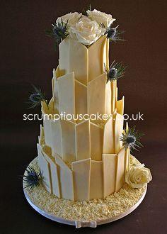 www.scrumptiouscakes.co.uk (646) - 4 tier white chocolate shards wedding cake with fresh white roses & thistles.