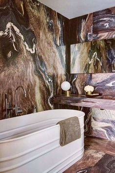 A colorful bathroom that mixes modern and luxury can be transformed by simply having a wall covered with colored marble.