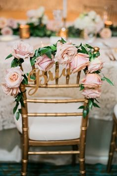 Pink Rose Chair Decoration   Kristen Weaver Photography on @eadweddings via @aislesociety
