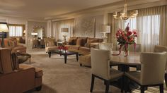The epitome of luxury, the two-bedroom Ritz-Carlton Suite offers panoramic views, separate living and dining rooms, a pantry kitchen and access to the Club Lounge