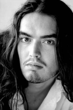 This pic of Russell Brand looks vaguely like my real high school boyfriend...or how I remember him anyway...he probably more closely resembled a long-haired John Belushi.