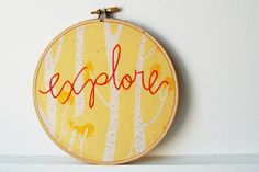 Embroidery Hoop Wall Art. Explore. Red on Yellow Tree Print Fabric. Embroidered Text by merriweathercouncil on Etsy