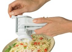 The perfect tool for grating parmesan cheese onto family-style pasta dishes, shaving carrots onto Asian-style salads, or adding last minute dark chocolate flakes onto decadent desserts, this convenient hand-held rotary grater features a durable crank mechanism for grating hard cheeses, chocolate, nuts or carrots smoothly and easily without hassle or mess. This efficient grater features a sturdy extra-wide non-slip plastic frame and handle for a secure and comfortable grip when shredding ...