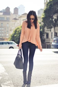 Blush blouse + dark jeans + boots. Great outfit.