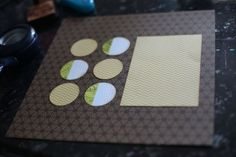"Before (oct 30 2011). Three papers: one for the background, one for a 4.5×6.5 inch block (for a photo mat? Or maybe you have other ideas!) then I added six 2"" circles – three in the same paper as the box and three from another sheet."