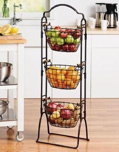 This 3-Tier Market Basket Stand is an attractive storage solution for any room of the house. It features 3 large baskets, each with natural acacia wood handles for a touch of rustic flair. The rack can also easily converts into a 2-tier stand, allowing you to use the remaining basket separately.