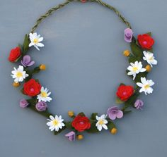 This gorgeous handmade felt wildflower wreath is the perfect decor for spring and summer. The unique wreath base is handmade from a soft green