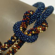 Rochelle ... Bracelet . Bead Crochet Rope . Earthy Colors . Autumn . Picasso Finish . Dark Navy Blue . Caramel . Cream by time2cre8 on Etsy https://www.etsy.com/listing/82510004/rochelle-bracelet-bead-crochet-rope
