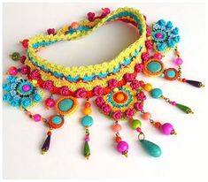 Free form crochet statement choker in colorful cotton,silk and viscose. It incorporates glass beads,artificial turquoise beads, metal elements(do not contain nickel). It fastens with a glass bead button;length is adjustable by moving the button(now set at 37.5cm). Its lightweight and resistant,there are no glued elements. The earrings featured in photos 4 and 5 are included in the price. You can find the matching bracelet here…