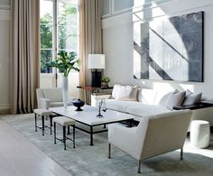 Clean and chic with Tom Brydelsky over the couch. #encaustic #painting #white #interior