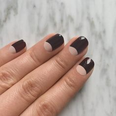 To The Moon And Back - There's nothing sexier than a darkredpolish that's almost black, andpairing it with a soft nude keeps it ladylike. After your base coat, apply two coats of a light nude polish. Draw the half moon outline with thedeeper shade, and fill in the space above the moon to the tips of the nails. Allow the polish to dry completely (to avoid streaks) before sealing with a topcoat.