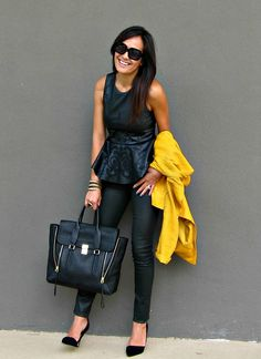 Peplum top, black skinnies, heels.