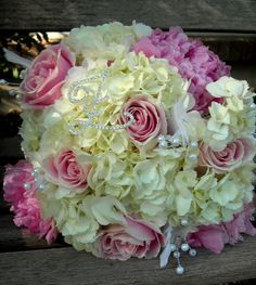 bridal bouquet//so sweet, really pretty...with streamers of satin ribbon hanging down