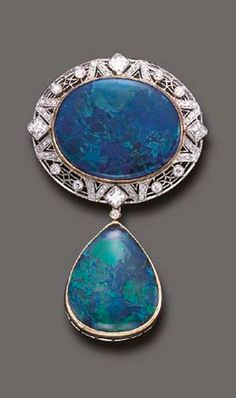 A FINE BLACK OPAL AND DIAMOND BROOCH  The oval-shaped black opal plaque, within a pierced single and old European-cut diamond surround, enhanced by square-cut diamond accents, suspending a drop-shaped black opal pendant, mounted in platinum and 18k gold.