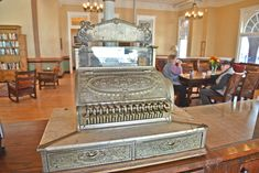 An antique cash register graces the lobby of the Castaneda Hotel
