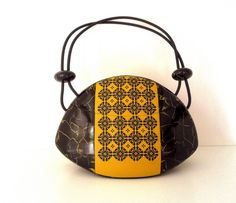 Wearable vessel-bag by Enkhe Tserenbadam, via Flickr