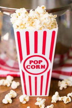 Movie theater popcorn in a red striped popcorn bucket Popcorn Theme, Popcorn Snacks, Popcorn Bucket, Popcorn Recipes, Gourmet Recipes, Movie Theatre Popcorn Recipe, Movie Theater Snacks, Movie Popcorn, Foodtrucks Ideas