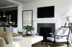 This design is modern and traditional at the same time. The simple molding is heavy and wide, but it also has a clean look, thanks to the mitered corners and the fact that it's white-on-white with the simple charcoal gray slab stone surround. This is a great design for someone with a modern aesthetic in a home with traditional architecture.
