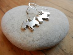 These are my favourite earings from Nina Parker -Working Glass Jewellery. Little dog earrings. Sterling silver hooks.
