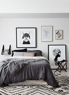 Monochrome Bedroom - Artwork: Ruben Ireland, Kreativitum, Kristina Krogh On bed: CULTIVER Linen, Louise Roe pink fence cushion, norsu silver grey sheepskin. Barnaby Lane folding stool, H&G leather strap bedside shelf. Halcyon Lake rug. Styled by Jacqui Moore & Julia Green for Greenhouse Interiors and photographed by Lisa Cohen photography.