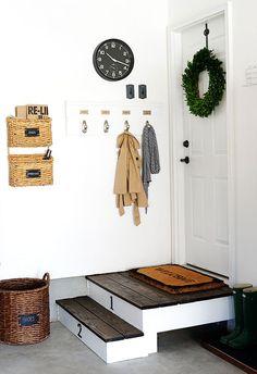 Hang coat hooks next to your garage door.