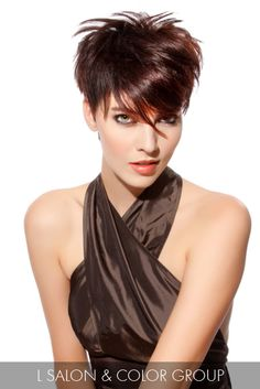 This chocolate-cherry pixie with complex layers is the perfect showcase for a modern cut that tailors to the wearer's individuality.