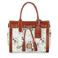 Celebrate the 75th Anniversary of Walt Disney's animated classic, <i>Bambi</i>. Stroll in the urban forest clutching your petite satchel purse by Dooney & Bourke with an illustrated pattern and fine leather finishings.