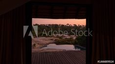 Stock Footage of A slow linear dolly shot from the inside of a luxurious private African lodge with a view onto the patio deck with swimming pool and river in the distance at dawn, just before sunrise. Explore similar videos at Adobe Stock Before Sunrise, Stock Video, Stock Footage, Distance, Dawn, Swimming Pools, Adobe, Shots, Trees