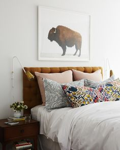 Dark tufted headboard // prints // art in bedroom