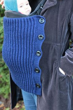 Free knitting pattern for Baby-Wearing Blanket - This ingenious blanket by Playing with Fibre adds an extra layer to keep baby warm while in a carrier or sling. It attaches conveniently to buttons of your jacket or sweater for easy removal without disturbing your baby. It also has an option for attaching to the baby carrier itself. Made of ribbing to stretch with your growing baby.