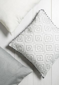 Is your couch looking sad and drab? Throw on this geometric aztec print cushion cover with adorable small pom poms around the outer edge. Your space will thank you.