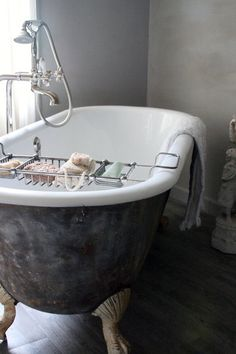 Claw Foot Tub. LOVE IT!!!! hunting for one of these in our area to replace the tacky plastic thing that we have now....this is much more suitable to a house that started being built in the 1800's ;)
