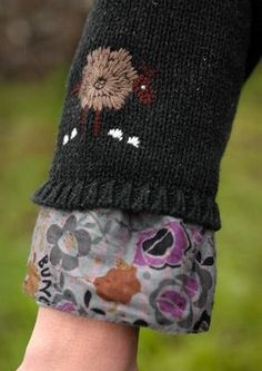 great way to add length and style to sweater sleeve, folksy embroidery stitching