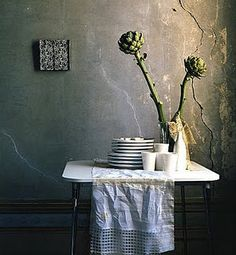 The cracked and peeling wall just adds to the charm. Notice the beautifully-detailed baseboards...