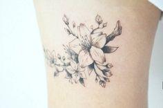 Illustrative cherry blossom tattoo on the right thigh. Tattoo...