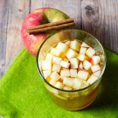 Cinnamon Apple Cider Sangria http://yumgoggle.com/cinnamon-apple-cider-sangria/ The Redhead Baker by Coleen Hill