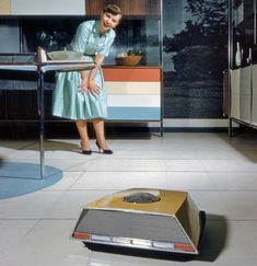 "Robo-vac. This image is from a Whirlpool ""Miracle Kitchen of the Future"" display at the American National Exhibition in Moscow in 1959. via reddit"