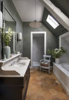 The bathrooms were fitted with antique sink cabinet and the floors are tiled with vintage 18th century terracotta.