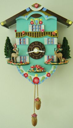 Adorable, kitschy cute, turquoise chalet cuckoo clock with deer and toadstools. By Emmelene on Etsy. Check out this shop!!